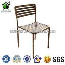 eski brozen metal bahçe yan sandalyeler