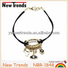 Black elastic band bracelet with lucky eye charm pendant