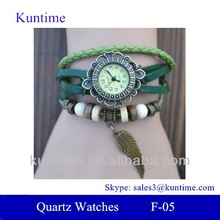 bulk buy from china Quartz watch F-05 for girls with Wing pendant,leather strap, bronzed watch case
