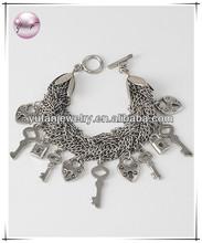 Burnished Silver Tone / Lead&nickel Compliant / Toggle Closure / Lock & Key Charm Bracelet