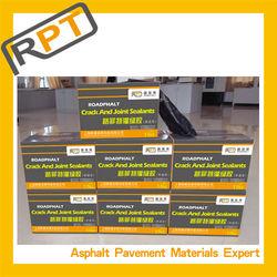 Professional sealant on road repair material