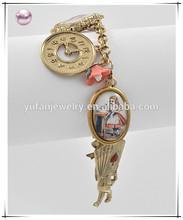 Antique Gold Tone Finish Multi Color Acrylic Lead nickel Compliant Toggle Closure Alice In Wonderland Charm Bracelet