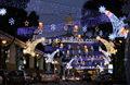 escena al aire libre decoración de navidad alas de ángel estilo de luces de la cuerda