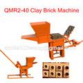 El trabajo en casa de ladrillo de arcilla que hace la máquina manual de la prensa qmr2-40