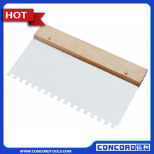 Notched glue spreader with wooden handle, polished blade