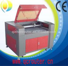 QC1290 CE low price high quality tree tree laser cutting machine cnc laser cutting machine price