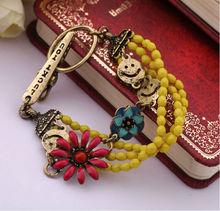 Antique gold acrylic bead and flower beaded bracelet