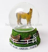 resin horse inside snow globe