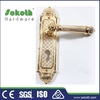 Gold polished front door handles and locks on plate Dubai