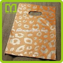 Yiwu China leopard print cheap pe die cut shopping bag wholesale