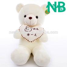 Stuffed bear holding a heart