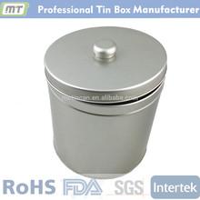 round tin tea pot with a handle