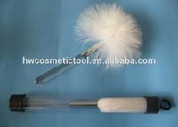 white feather fingerprint brush