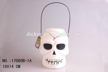 White skull pumpkin candy bucket for Halloween
