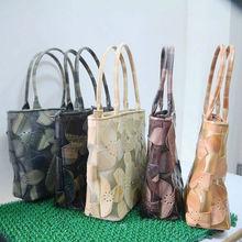 Fashionable pu leather clover pattern handbag grid bag