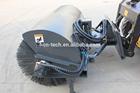 snow sweeper machine on skid steer loader