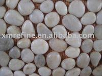 white pebble on net / cobblestone