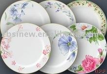 White ceramic dinner plate with flower design