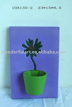 interesting ceramic flower pot wall plaque
