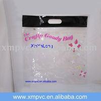 Black handle pvc garment packaging bag with ziplock closure XYL-HB150