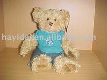 teddy bear in blue T-shirt