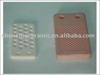 Welding wear resistant ceramic bricks