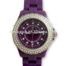 Plastic wristwatch with diamond metal bezel