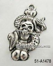 Tibetan style metal pendant, snake with skull