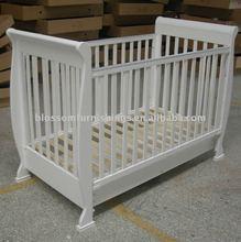 white wooden baby cot/baby crib
