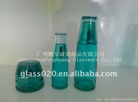 blue glass cosmetic bottle and jar