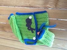 green hand knit sweater