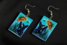 Blue dangle earrings with kittens