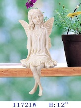 "H: 12"" Polyresin fairy sitting in antique white color"