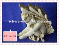 kissing angel figurine