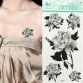 cuerpo arte del tatuaje temporal de tinta y papel de etiqueta