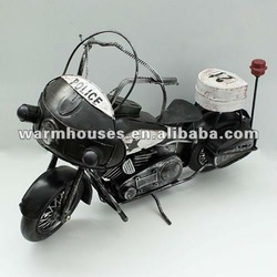Wrought iron motorcycle/desktop adornment is placed (black)