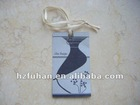 the vase picture hang tag and white string