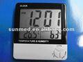 tabla de reloj con termómetro y la humedad