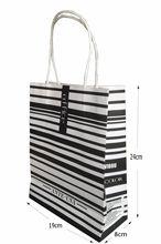 Hot sale custom paper bag & strong reinforcement/brown kraft paper shopping bag/manufacturer/handle is ribbon rope