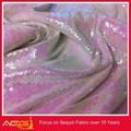 La vendita calda top 100 design 100% poliestere abbastanza caldo vendita scintillio di paillettes tessuto tessuto in fibra ottica