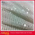 A venda quente superior 100 design 100% poliéster flexível flossy luxo tecido de lantejoulas tecido tule rosa