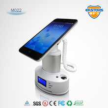 smart phone stand with charger stands and displays electronics retail shop