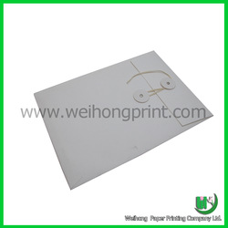 White mailing paper envelope with string