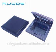 Shiny plastic powder compact case