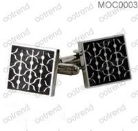 Square cufflinks with black epoxy