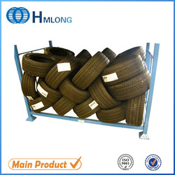 Large blue metal stacking truck tire storage rack for auto industry