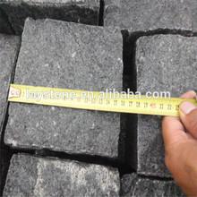 Factory direct black basalt cobblestone paver vogele
