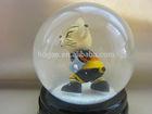 Resin cat hockey player inside snow globe