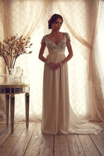 Gorgeous shining crystal beaded cap sleeves chiffon open back arabic wedding dress