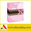 pink paper bag with ribbon, gift paper bag